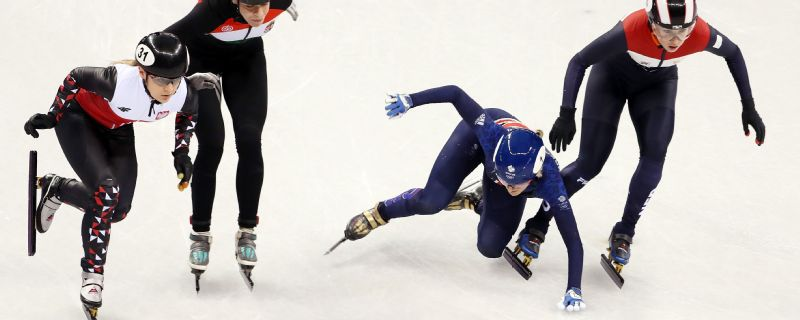 Elise Christie falls at the start of her heat in the 1000m short-track speed skating -- she would get back up and finish second after a restart, only to then be disqualified.
