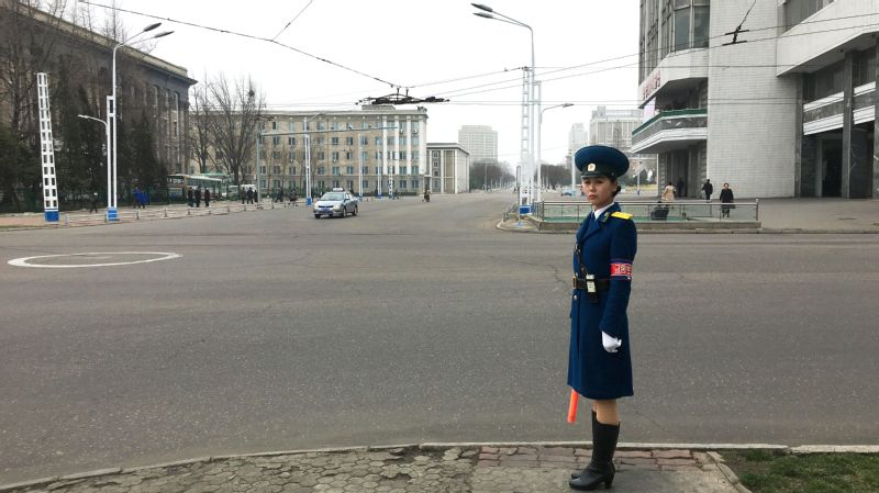 A traffic guard stands at attention in Pyongyang. I encountered her during a rare opportunity to walk a few city blocks at one point in the tour, but the up-close observation was quickly interrupted by my guide, who hustled me back to the bus.