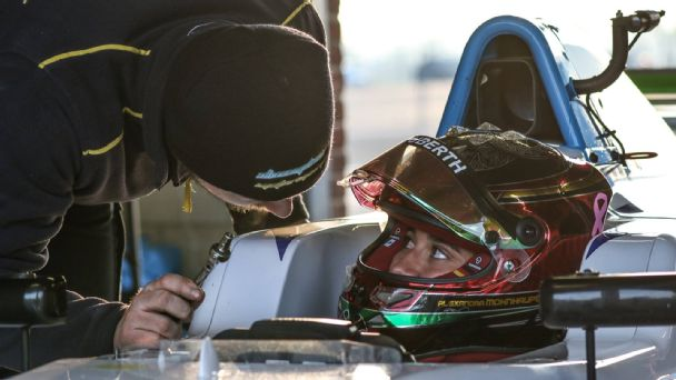 Mexican driver Alexandra Mohnhaupt listens to her Douglas Motorsport mechanic as she prepares for the British F3 Championship.