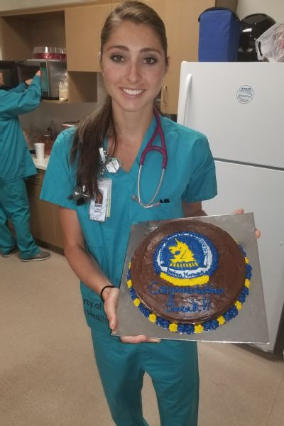 Sarah Sellers with a cake her coworker, Kim, made for her after the Boston Marathon.