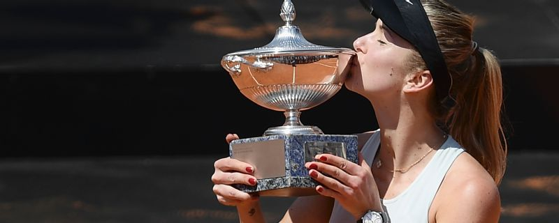 Ukraine's Elina Svitolina kisses the trophy after winning the women's final against Romania's Simona Halep