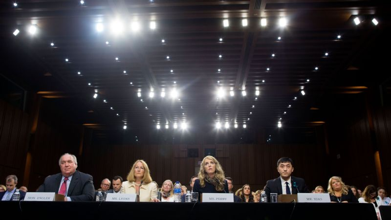 Outside of some senate hearings, Kerry Perry, second from left, the head of USA Gymnastics, has kept a low profile. Some gymnasts, including Simone Biles, think she needs to speak up more.