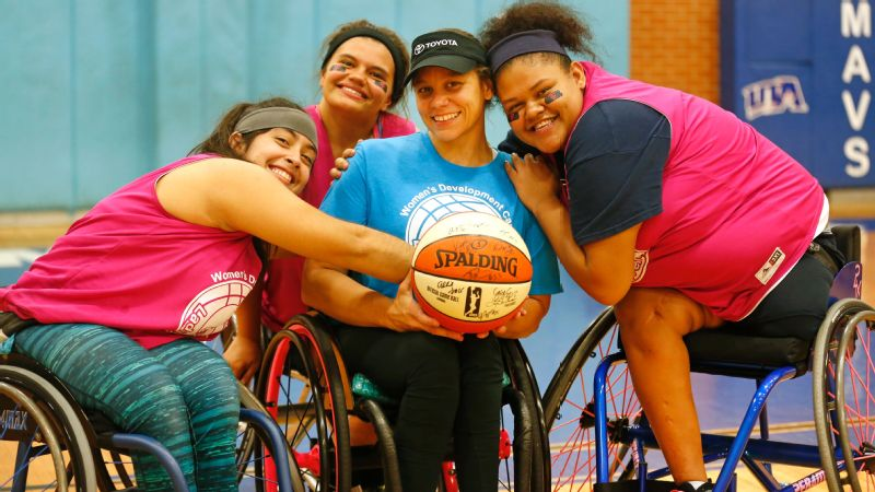 Darlene Hunter, center, with attendees from the Lady Mavs women's wheelchair development camp.