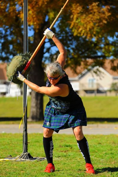 Terri Ventress competing in the sheaf toss, which simulates throwing hay with a pitchfork.