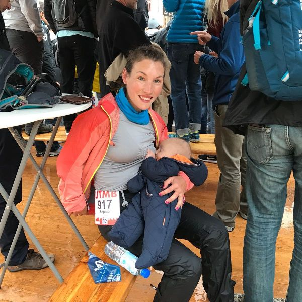 Sophie Power breastfeeding at the start of the UTMB ultramarathon.