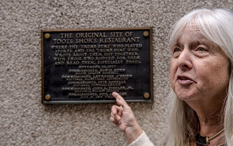Ludtke points at a plaque with the name of former MLB commissioner Bowie Kuhn on it on Monday.