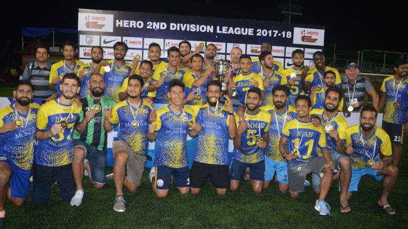 History made: Real Kashmir players celebrate with the Second Division trophy after beating Hindustan FC of Delhi 3-2 to win their league. They became the first club from Jammu & Kashmir to earn promotion into the I-League First Division.