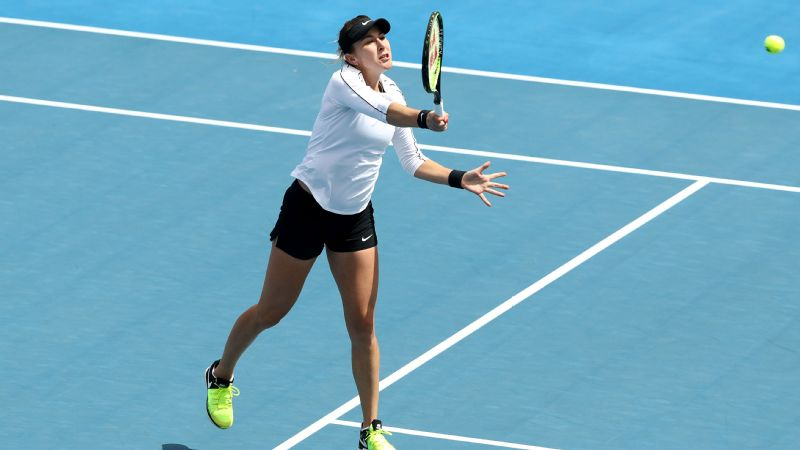 Belinda Bencic of Switzerland  plays a shot during her singles match against Zoe Hives of Australia.