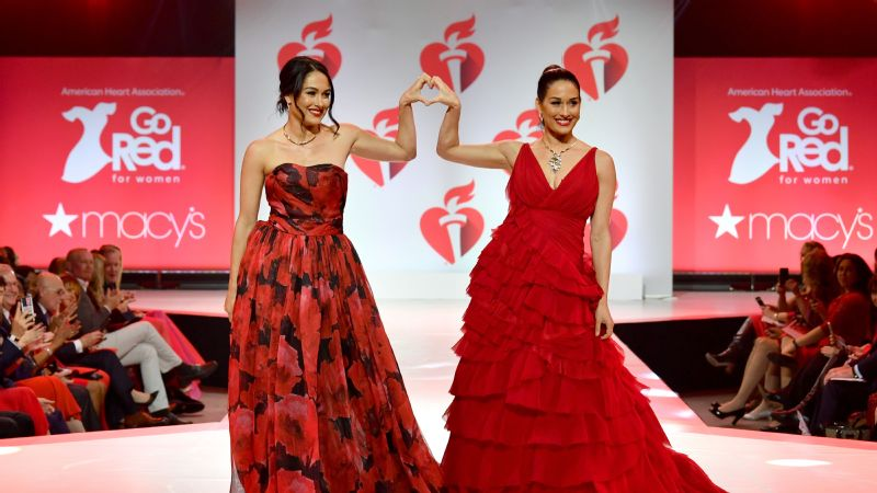 The Bella twins walk the runway for the American Heart Association's Go Red For Women Red Dress Collection in New York City.