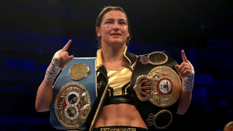 Katie Taylor celebrates victory over Kimberly Connor holding the WBA and IBF belts at The O2 Arena on July 28, 2018 in London, England.