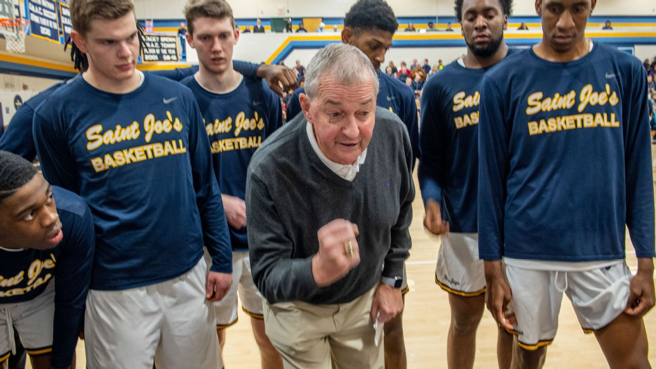 Saint Joseph's Head Coach, Jim Calhoun, encourages his players, who are mostly freshman, during a time out near the end of a close home game played at O'Connell Center on the West Hartford, Conn.