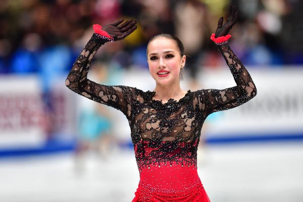 Russian AlinaZagitova waves to fans after winning the free skate with a score of 237.50 points at the figure skating world championships on Friday. Two-time world champ Evgenia Medvedeva finished third.