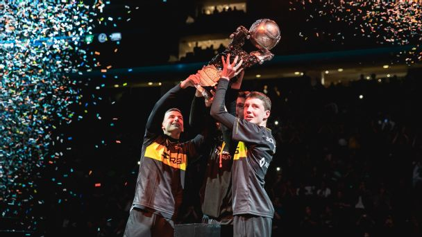 Renault Vitality lifts up the Rocket League world championship tropy.