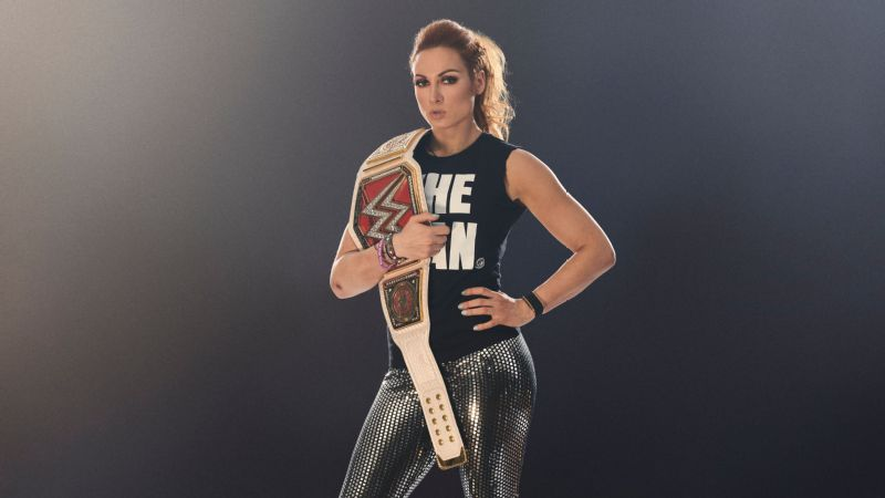 Becky The Man Lynch with her WWE Raw women's championship belt.