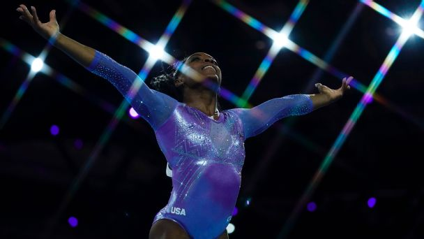 Simone Biles broke the record for medals by a gymnast at the world championships by winning the balance beam and floor exercise.
