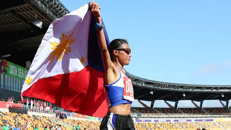 Christine Hallasgo of the Philippines won a gold medal after finishing the women's marathon with a time of 2:56:56.