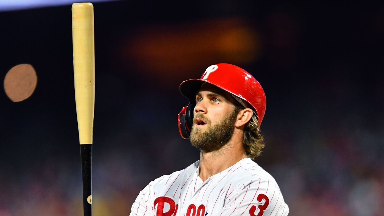Phils place Harper on paternity leave, recall Franco