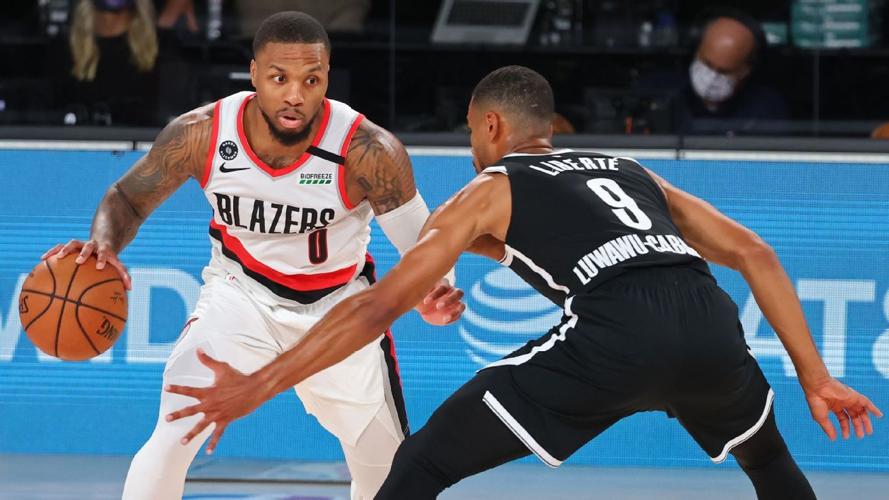 Dame, Blazers survive Nets to nab play-in berth