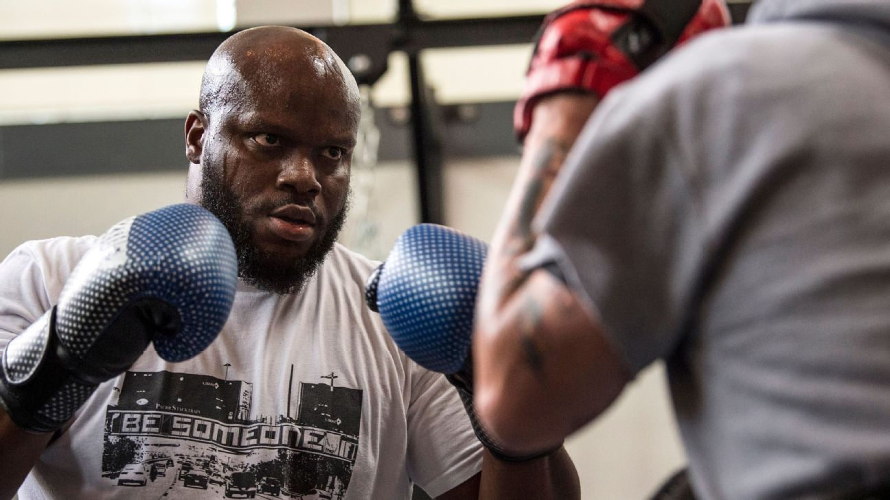 George Foreman couldn't convince Derrick Lewis to box, but he's still in his corner